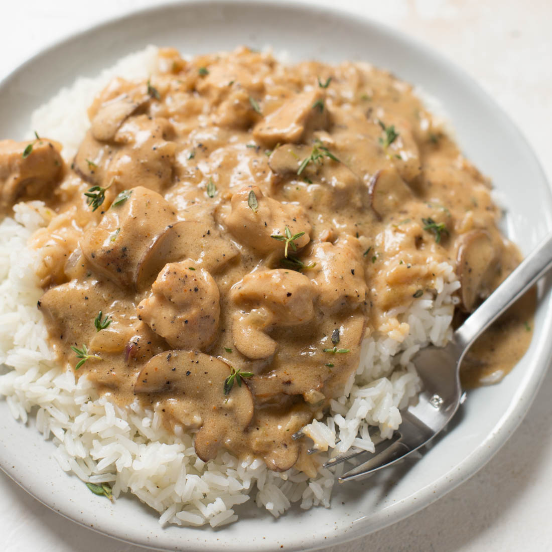 Chicken stroganoff served over rice