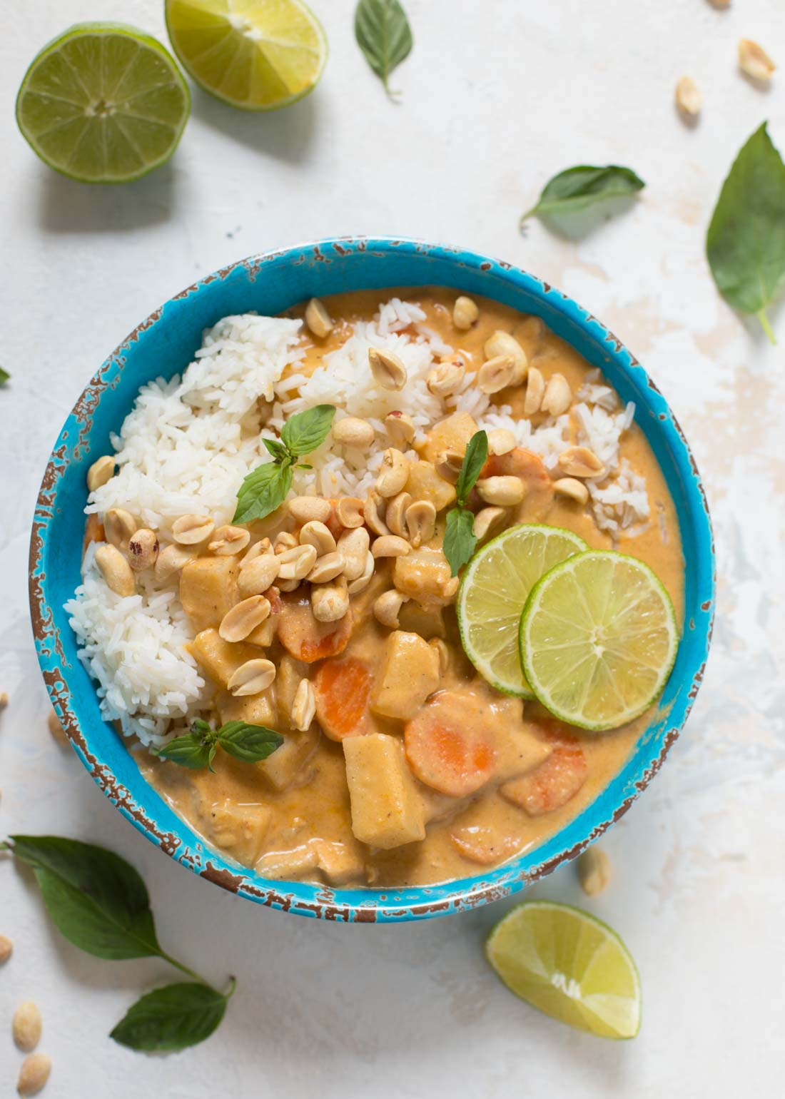 Chicken massaman curry with peanuts in bowl