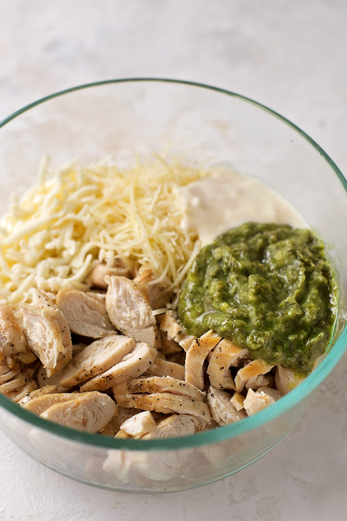 Ingredients for pesto chicken ring recipe in a mixing bowl