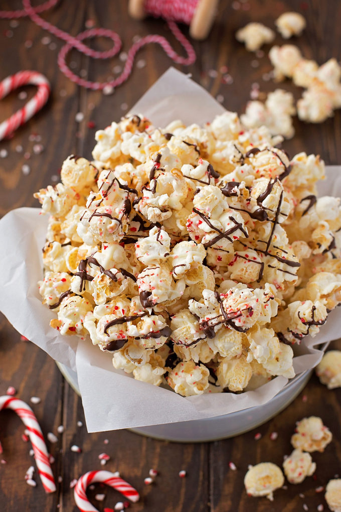 White Chocolate Peppermint Popcorn with a dark chocolate drizzle