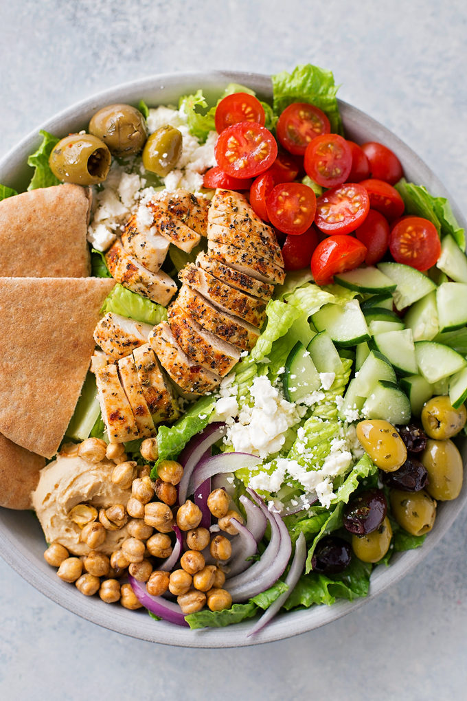 Gyro salad with chicken, tomato, cucumber, green olives, chickpeas, onions, and more.