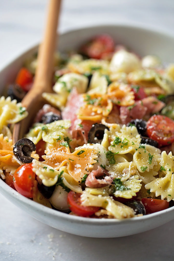 Close up of Italian pasta salad recipe in a white serving bowl