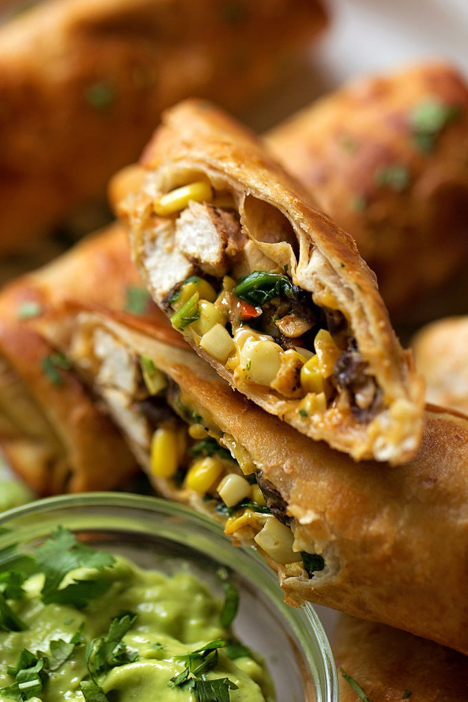 Southwest Egg Rolls cut in half to reveal the hearty filling