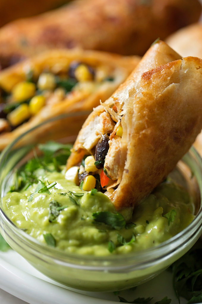 Southwestern Egg Roll being dipped in guacamole
