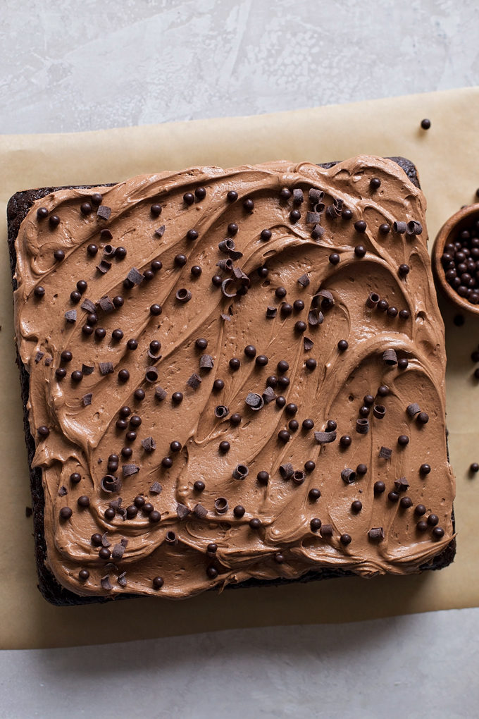 Baked and frosted square chocolate cake with cocoa buttercream.