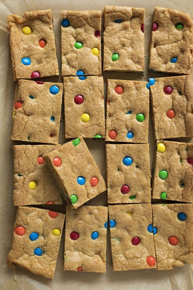 M&M cookie bars cut into squares and ready to be served. | lifemadesimplebakes.com