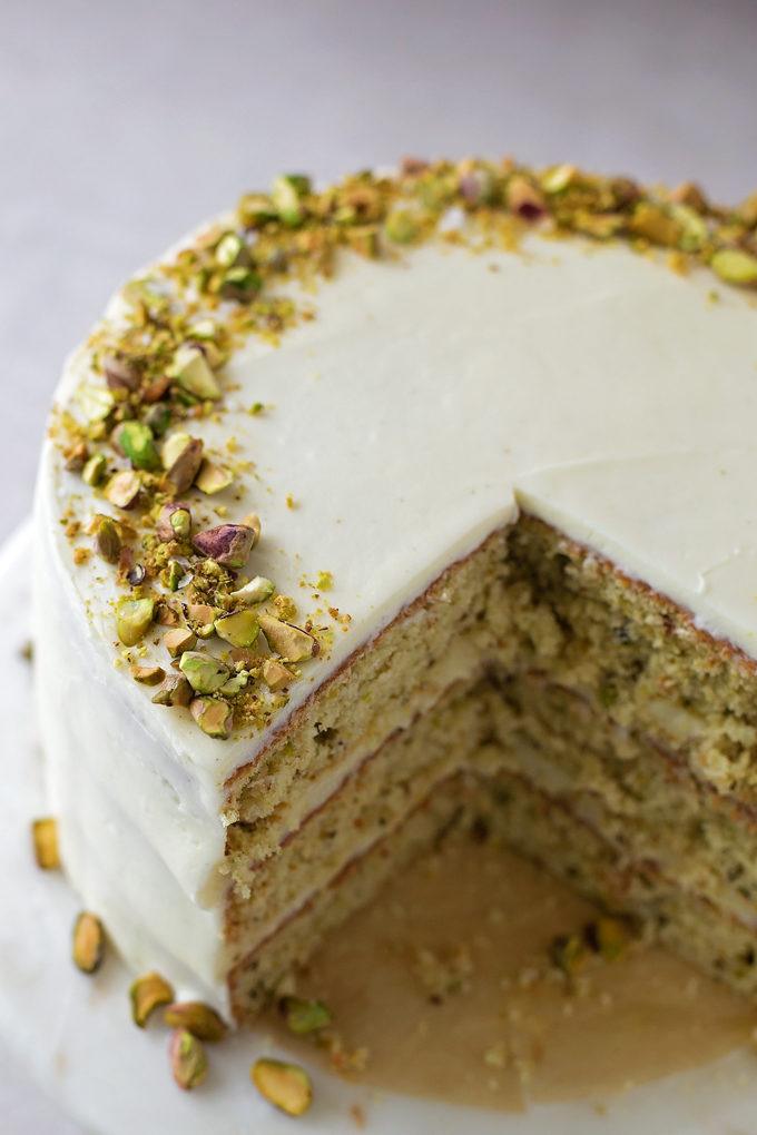 Pistachio Cake with a slice missing