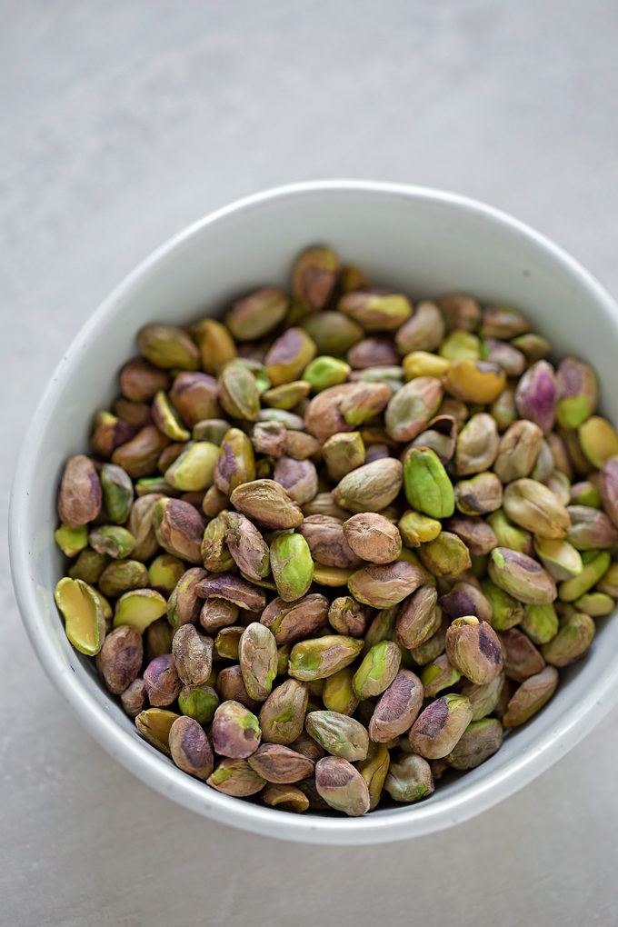 A bowl of shelled pistachios for pistachio cake recipe