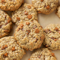 A pile of freshly baked cinnamon apple oatmeal cookies. | lifemadesimplebakes.com