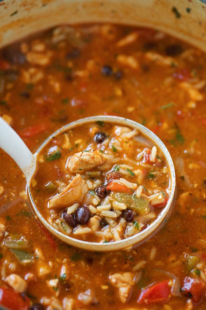 A ladle full of perfectly spiced fajita soup.