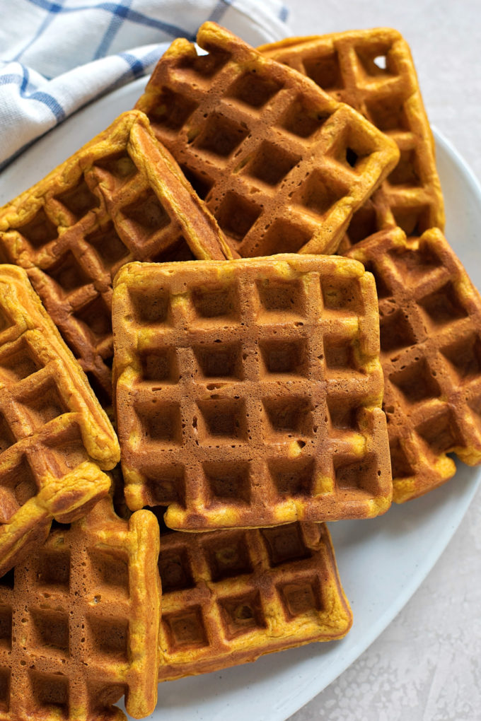 A platter of freshly cooked pumpkin spice waffles.