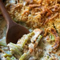 A spoon full of homemade creamy green bean casserole.