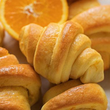 Orange dinner rolls.