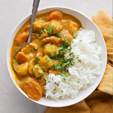 A bowl of yellow coconut curry chicken.