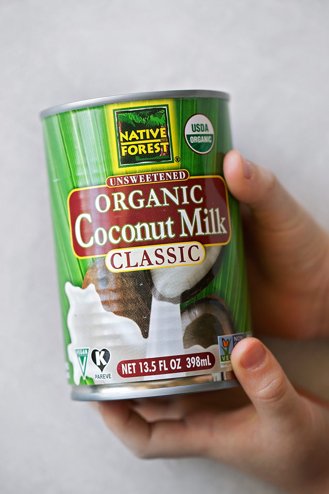 A can of organic coconut milk used in the recipe for yellow coconut curry chicken.
