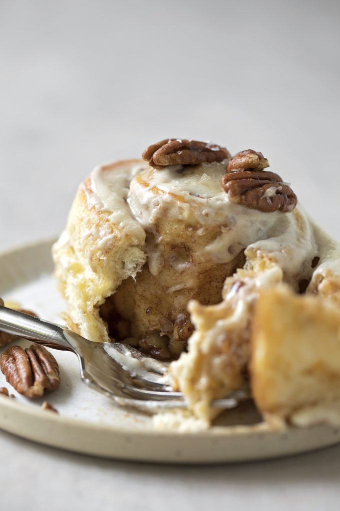 The gooey inside of a maple pecan cinnamon roll.