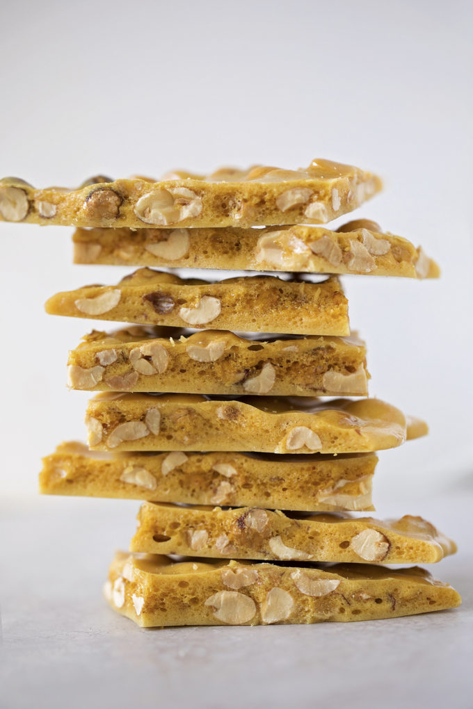 A tall pile of microwave peanut brittle made from scratch in just minutes.
