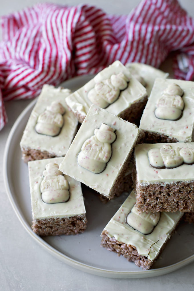 A platter full of sliced peppermint rice krispie treats ready to be served for Christmas.