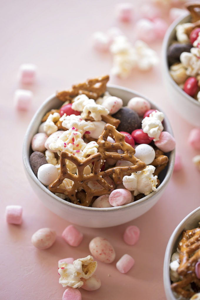 A bowl of peppermint snack mix. This sweet and salty mix is perfect for Christmas parties or gift giving!