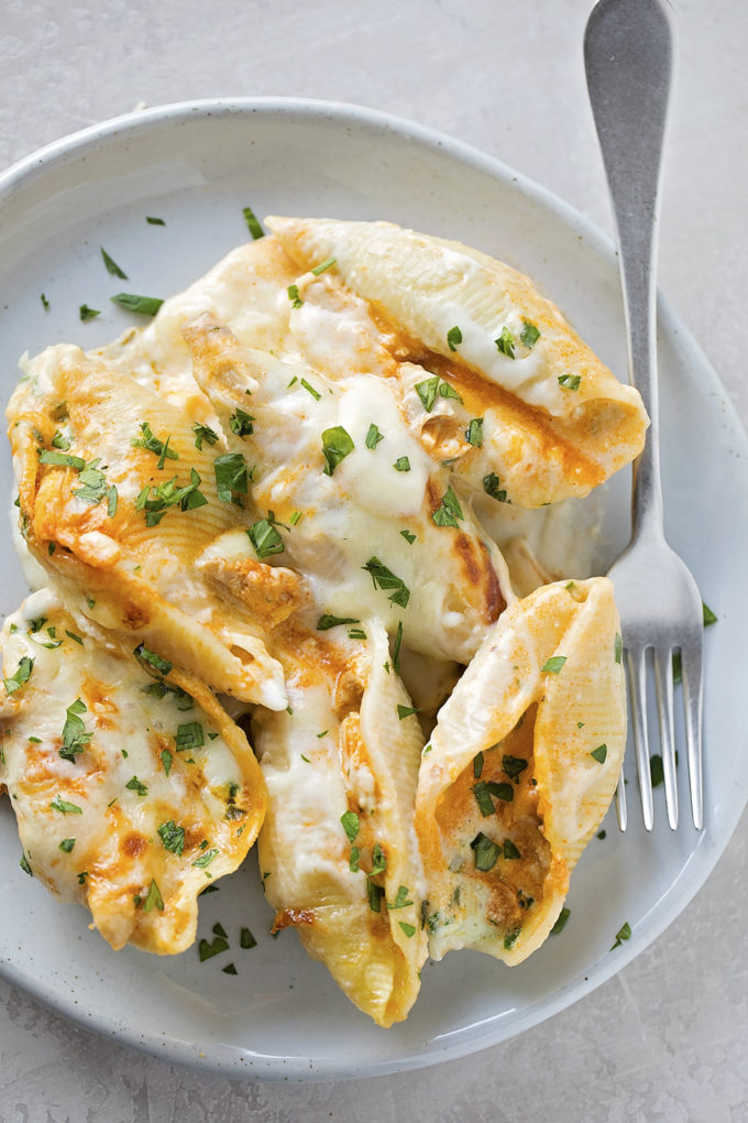 A plate with a serving of buffalo chicken stuffed shells.