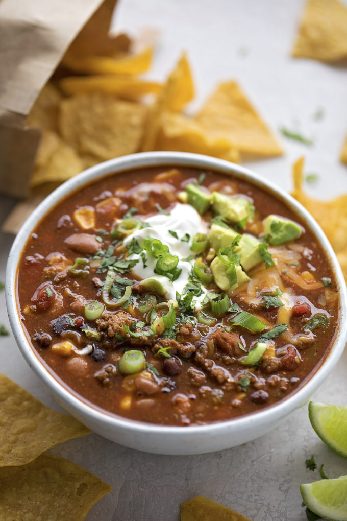 A bowl of easy taco soup with toppings