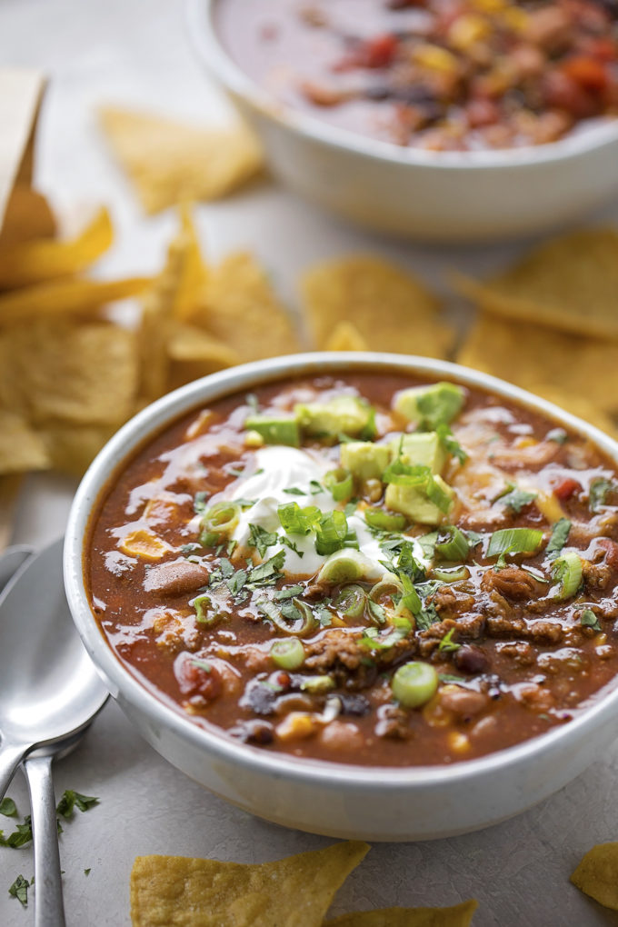 A cozy bowl of homemade easy taco soup with fresh tortilla chips.