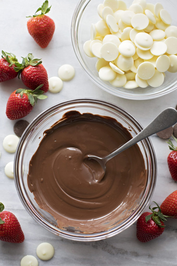 Step by step instructions for how to make perfect chocolate covered strawberries - the melted wafers ready for dipping.