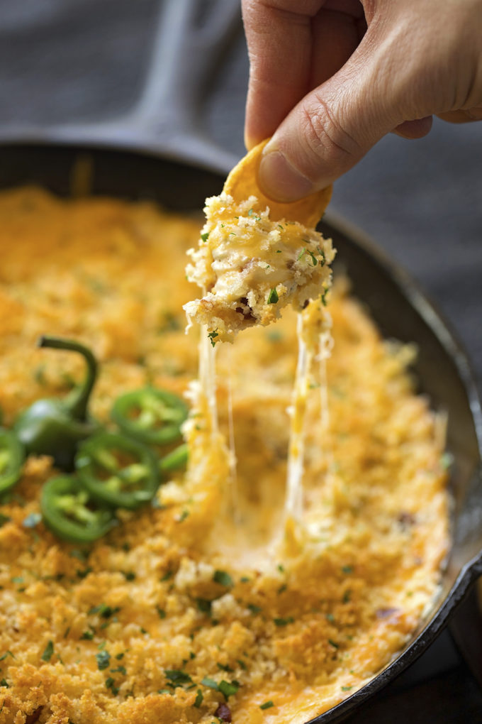 A cheesy scoop of warm cheesy jalapeño popper dip.