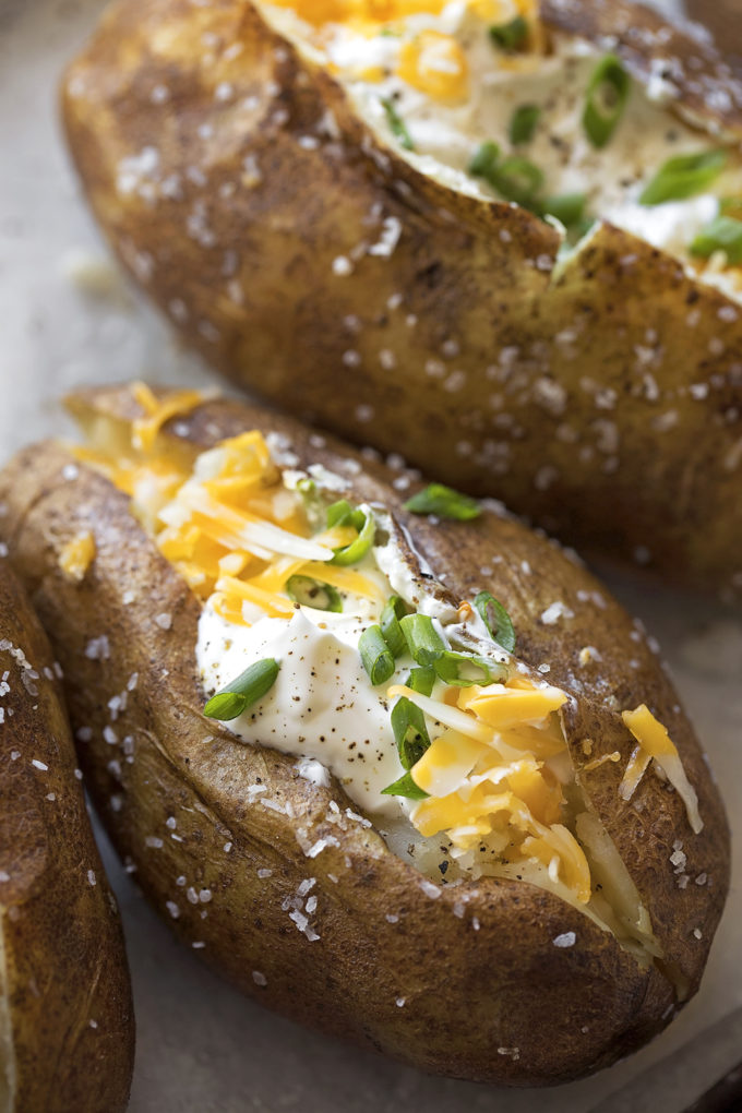 A close up of a loaded Instant Pot baked potato.