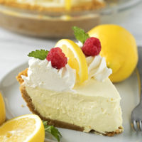 A slice of heavenly lemon cream pie served on a plate with garnishes.
