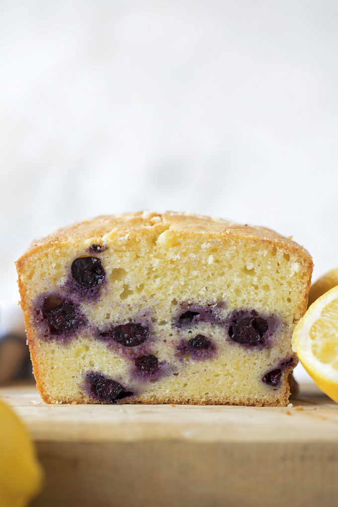 A look inside of a loaf of lemon blueberry bread.