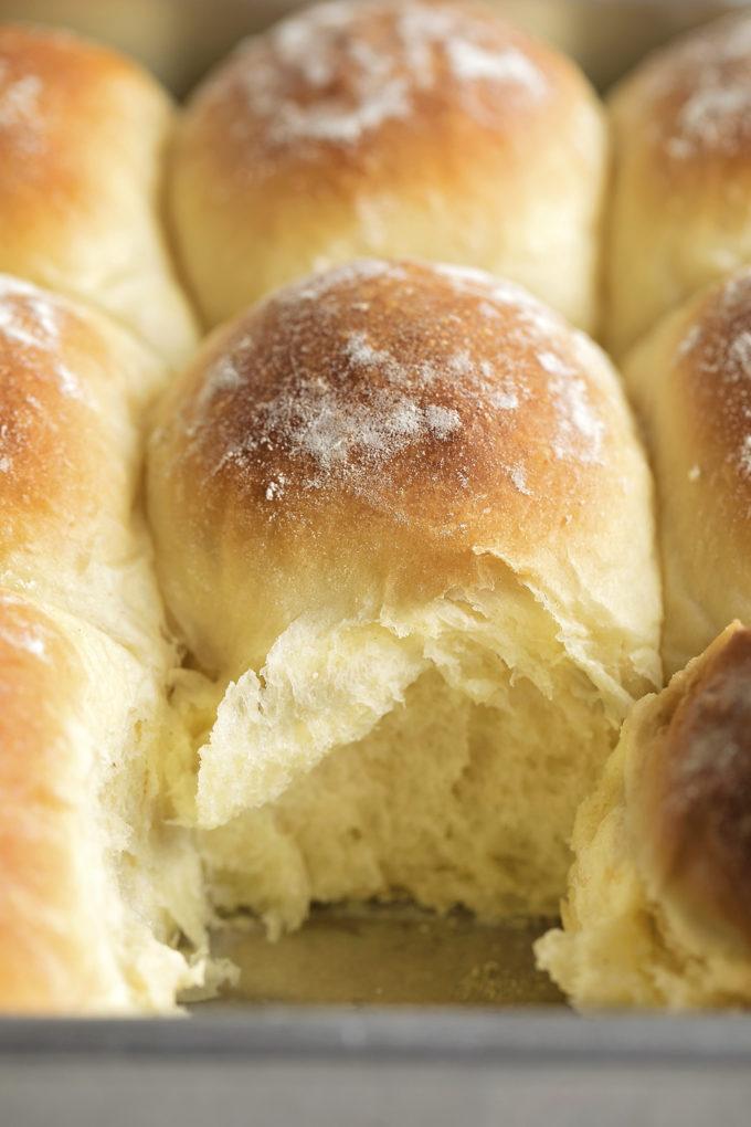 The tender, flaky inside of soft potato rolls.