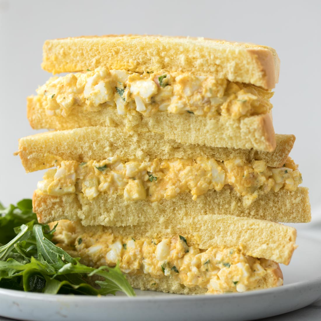 Egg salad on sandwiches stacked