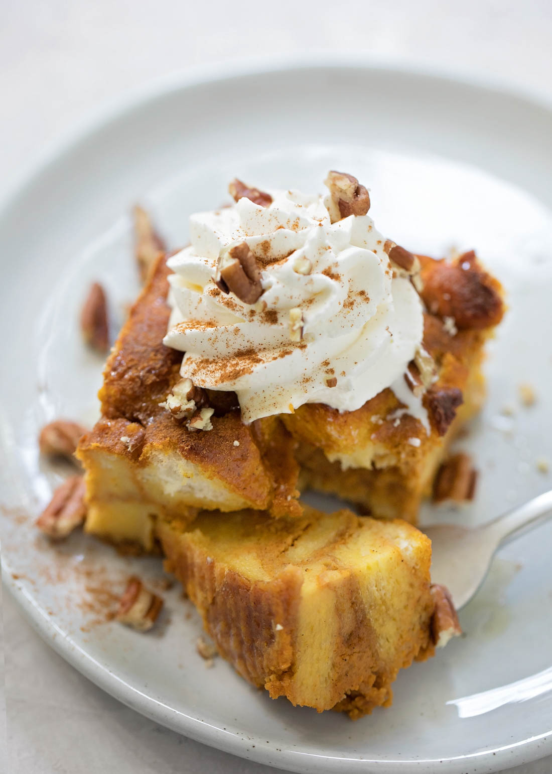 Bread pudding with pumpkin - on white plate
