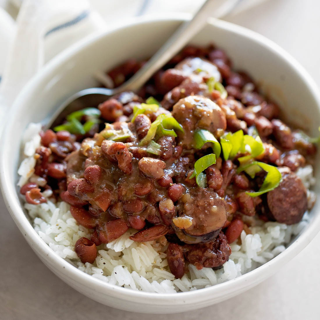 Red beans and rice in bowl with green onions