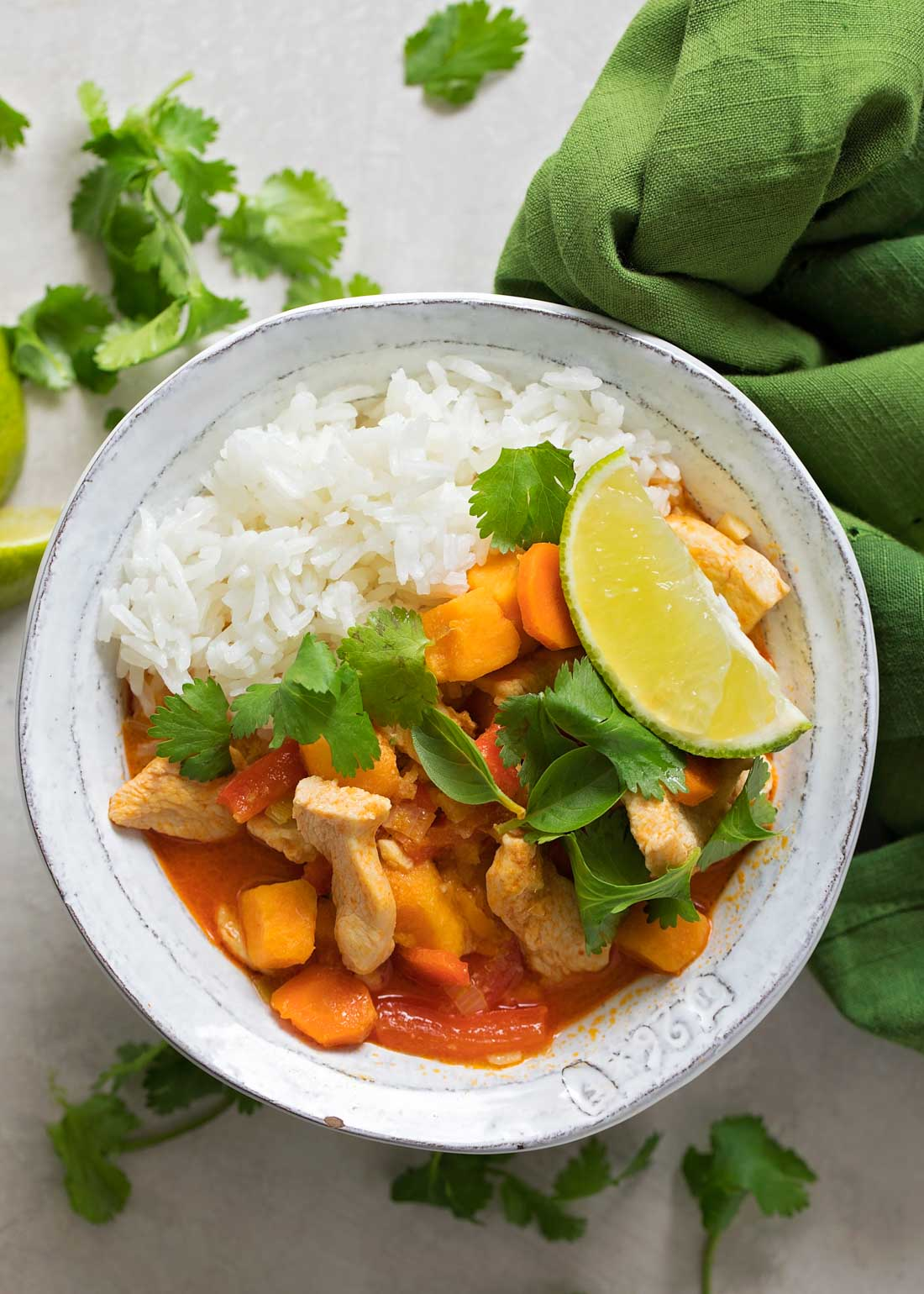 Red curry in white bowl