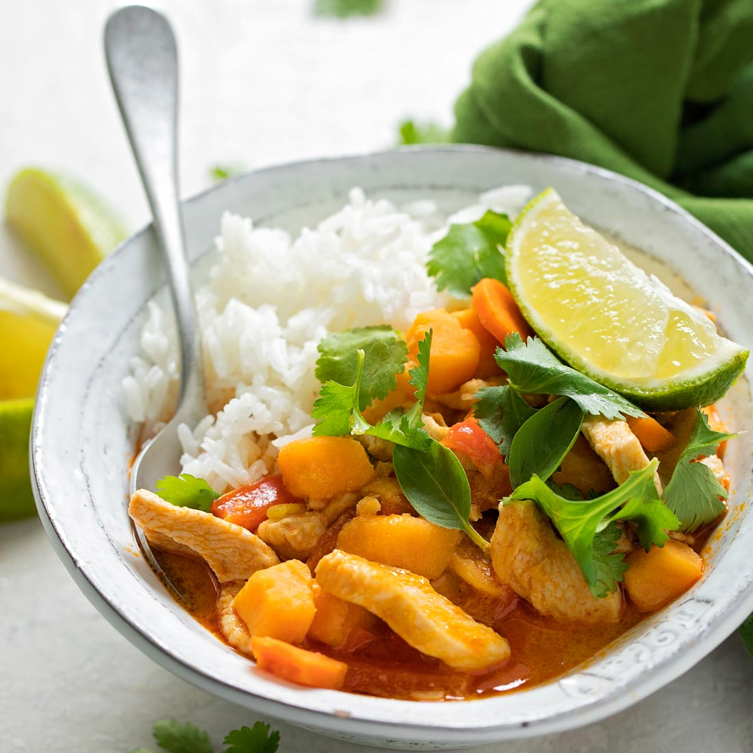 Red Curry chicken with veggies and rice in bowl