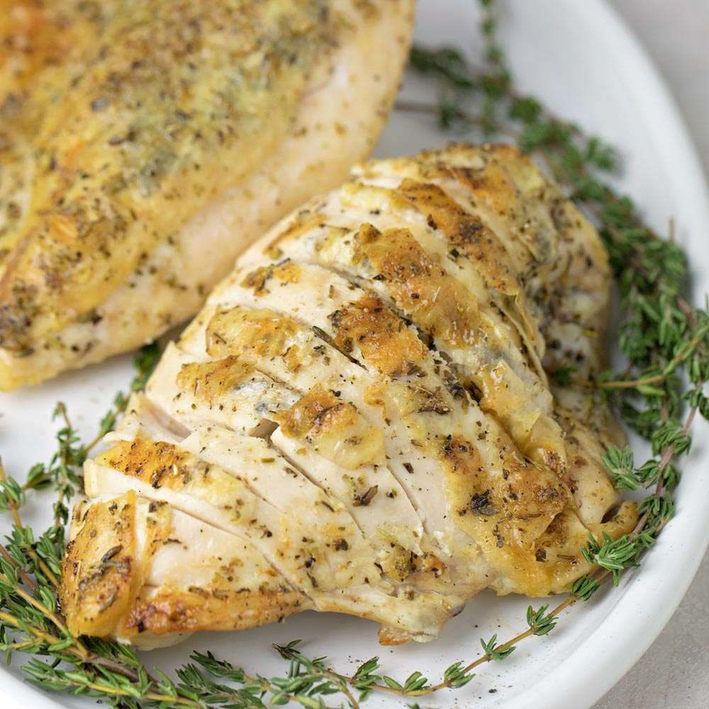 Bone-in chicken breast recipe on plate