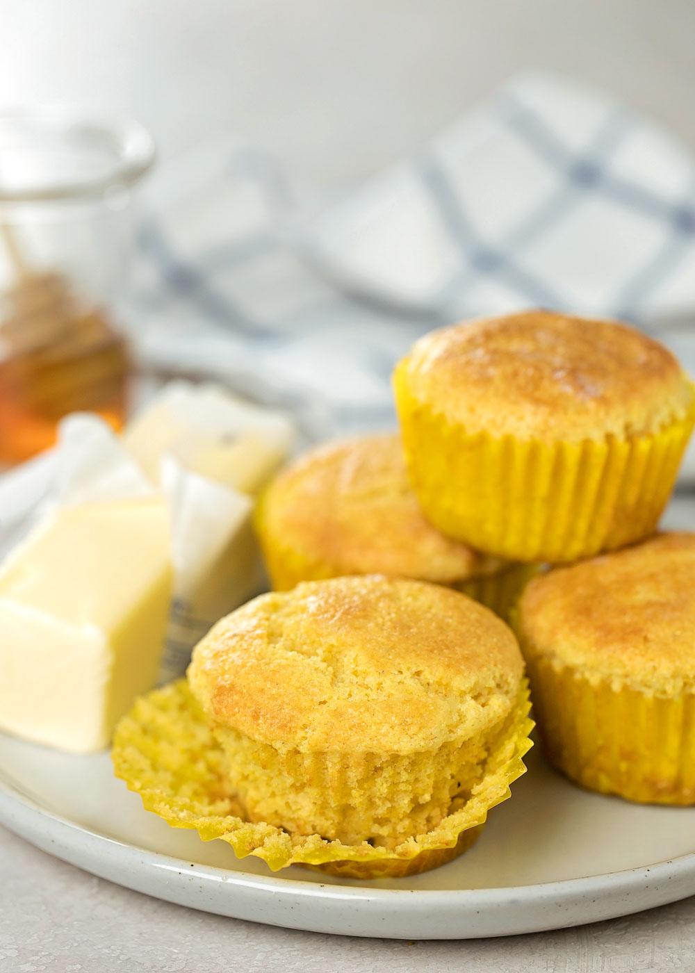 Honey cornbread muffins on white plate