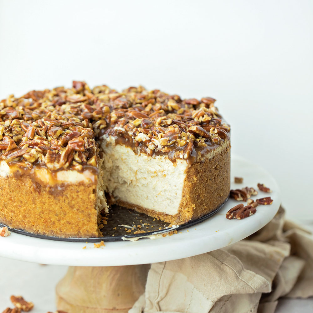 Pecan pie cheesecake recipe on cake stand