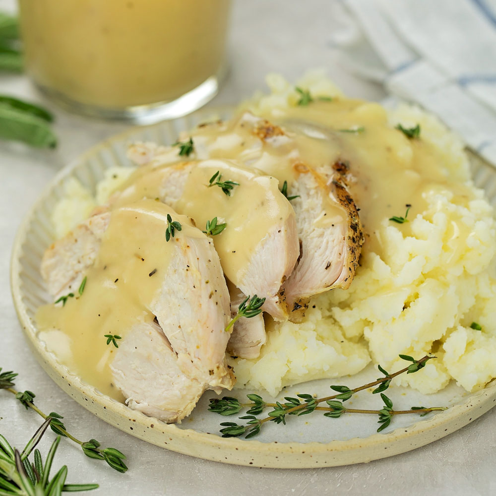 Homemade turkey gravy on turkey slices