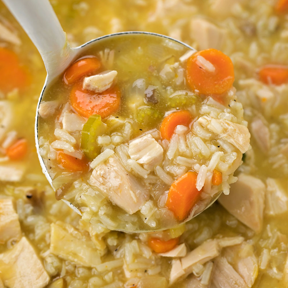 Close up of leftover turkey soup on ladle