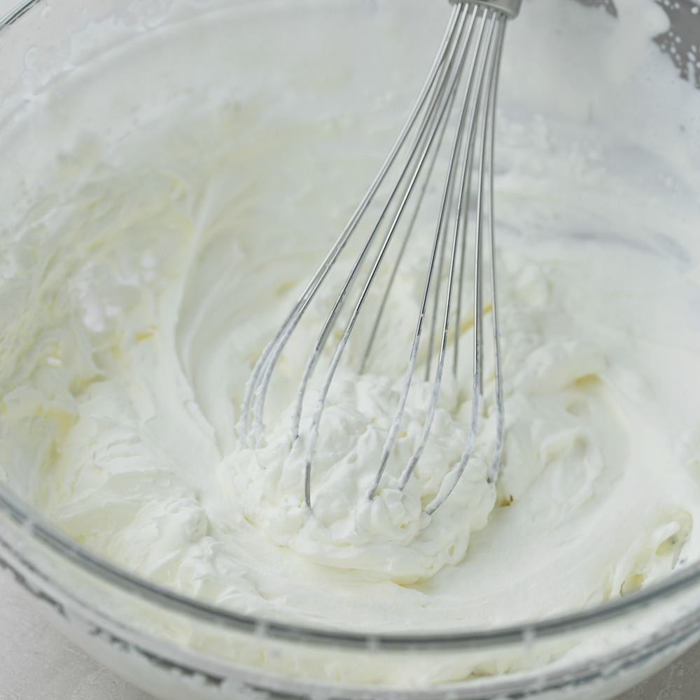 Homemade whipped cream being whisked