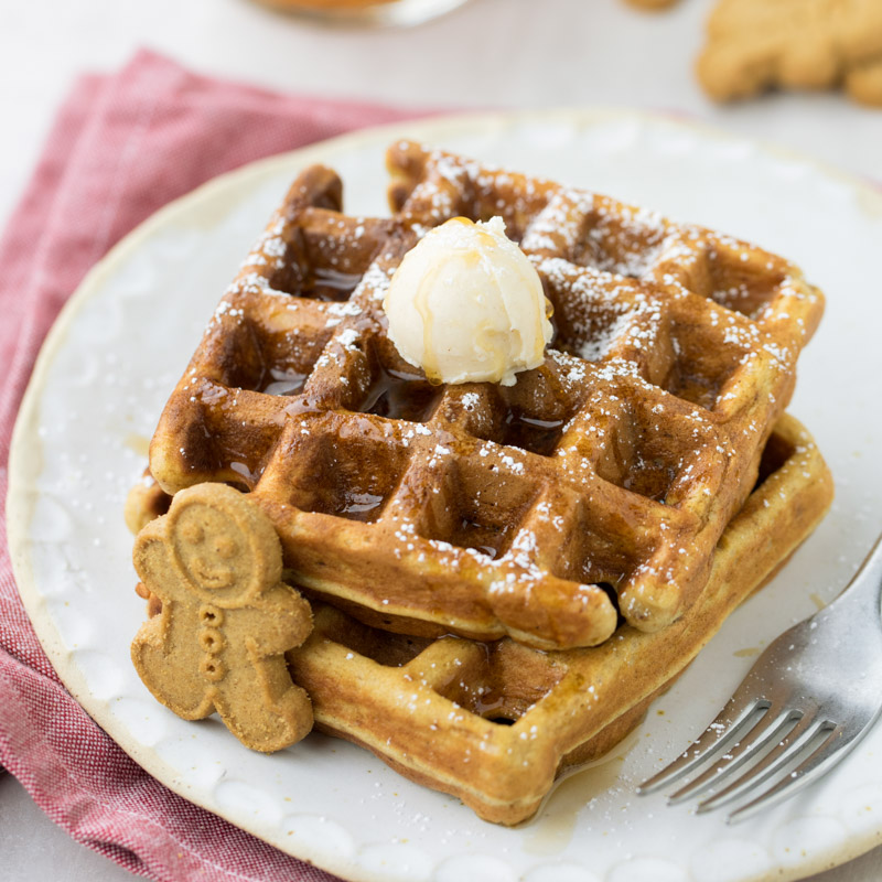 Gingerbread waffles with syrup, butter and powdered sugar