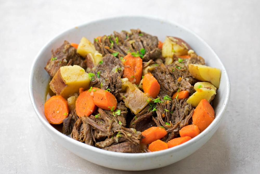 Instant pot pot roast in bowl with potatoes and carrots