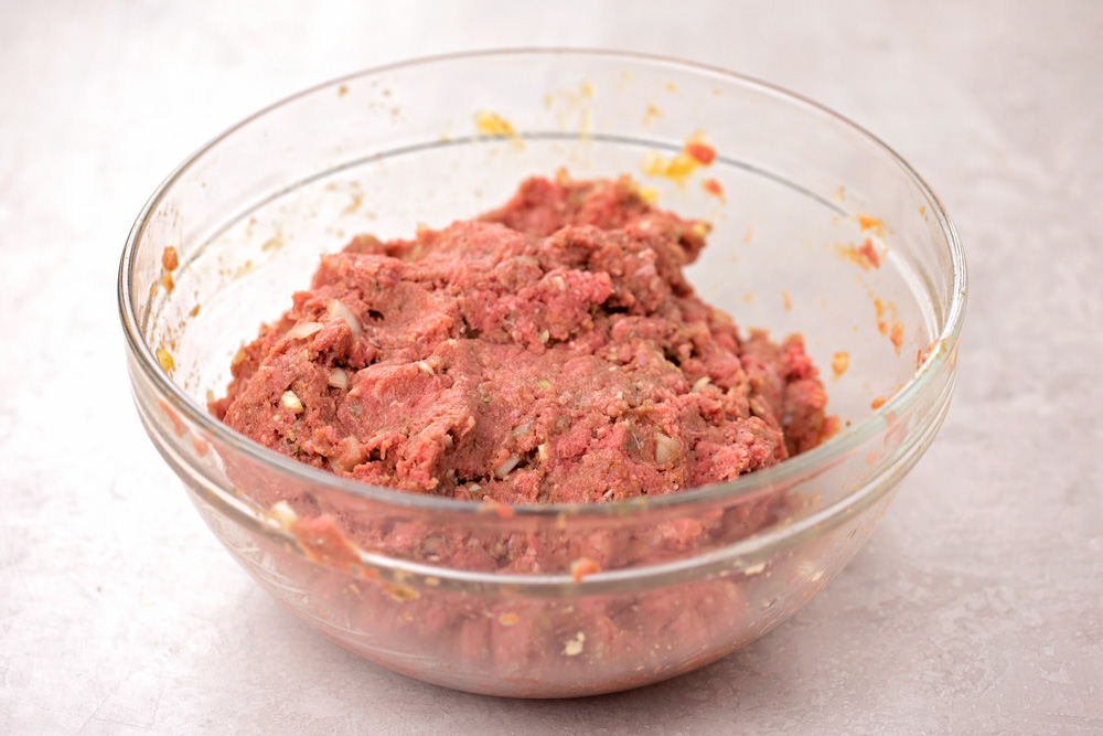 Ingredients for instant pot meatloaf recipe mixed in a glass bowl
