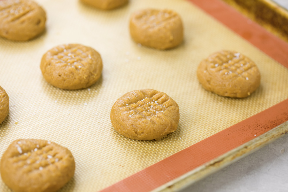 Balls of 5 Ingredient Peanut Butter Cookie Dough on a baking sheet
