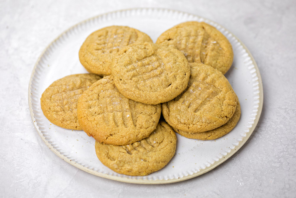 A stack of easy peanut butter cookies on a white plate