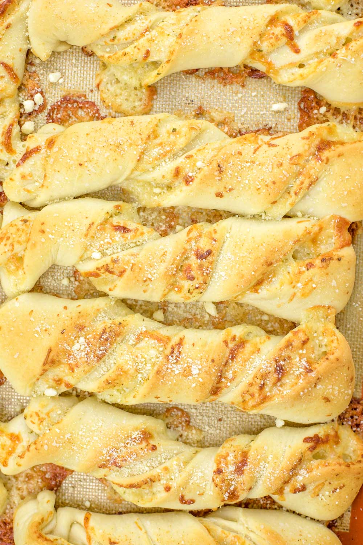 Cheese breadsticks on a baking sheet