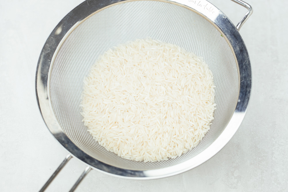 Rice in a mesh sieve before washing